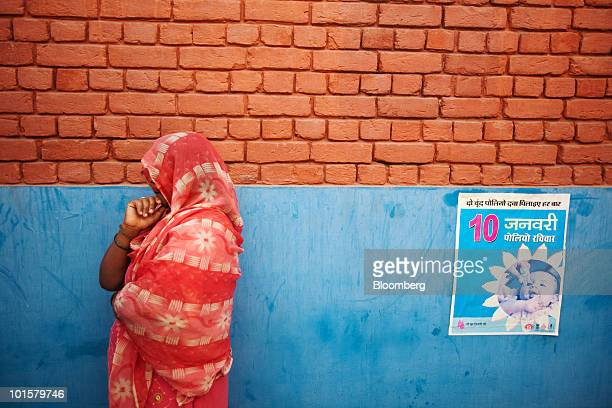 Sheela Rani, a 29 year old Accredited Social Health Activist worker, looks on at the Primary Health Care Center in Singhana, India, on Saturday,...