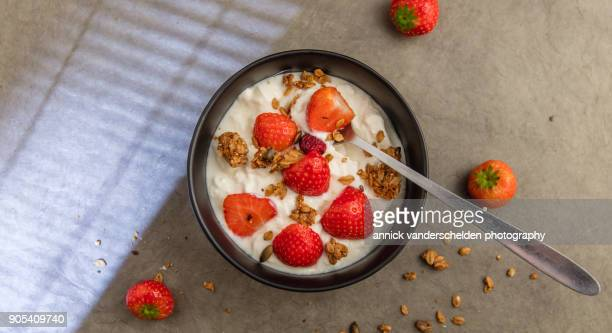 Sheep yoghurt topped with strawberries and granola.