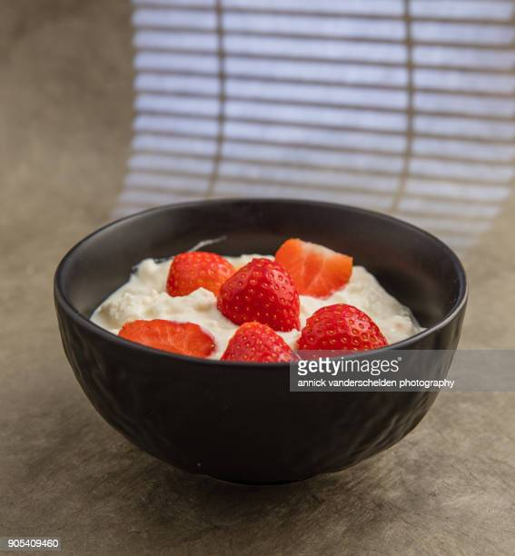 Sheep yoghurt topped with strawberries.