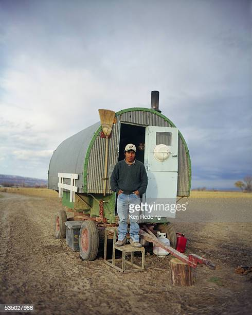 sheepherder standing outside wagon - gypsy caravan stock pictures, royalty-free photos & images