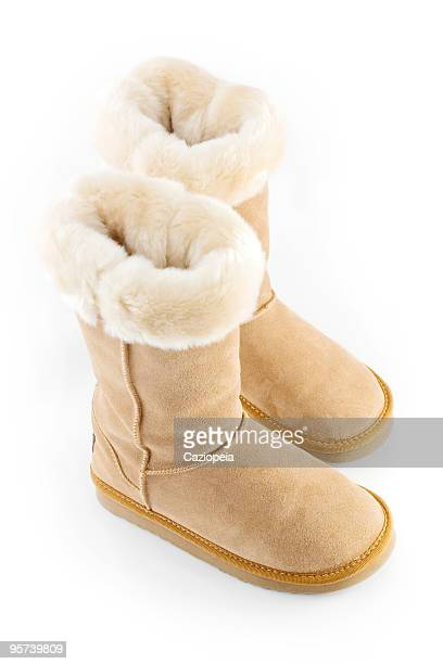 sheepskin boots - sheepskin boot stock photos and pictures