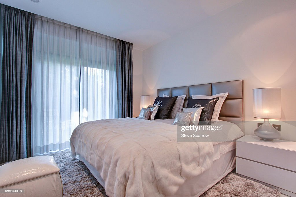 Sheer curtains in bedroom : Stock Photo