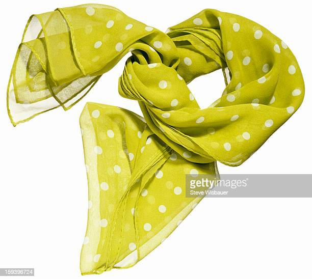 A sheer lime green scarf with white polka dots