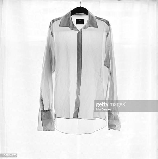 Sheer white shirt hanging backlit