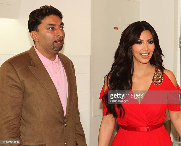 Sheeraz Hasan and Kim Kardashian attend the opening of the new Millions of Milkshakes store at Dubai Mall on October 14 2011 in Dubai United Arab...
