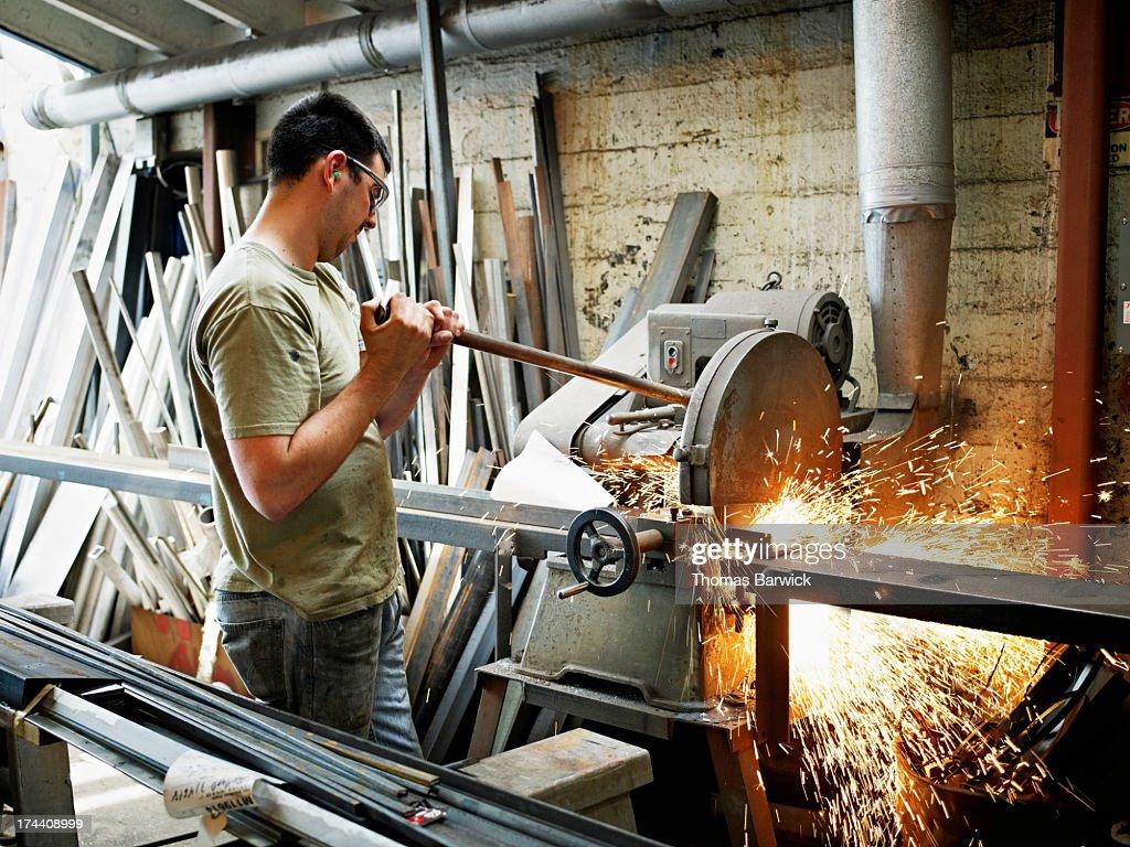 Sheet Metal Worker Cutting Bar In Stock Photo