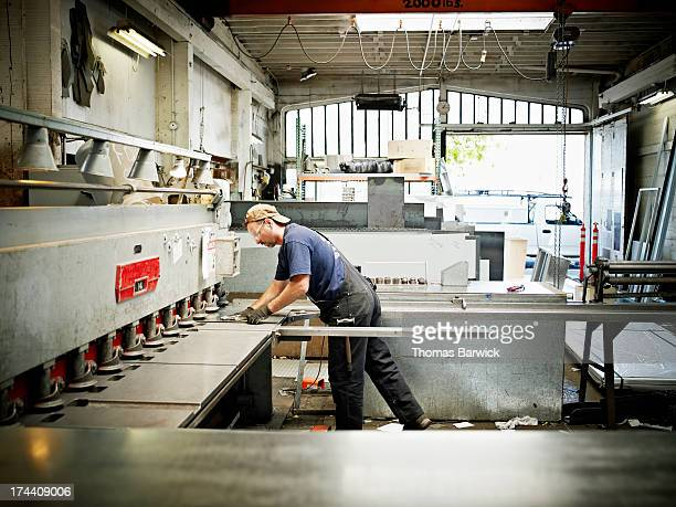 Sheet metal worker working on metal on break press