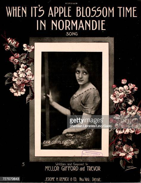 Sheet music cover image of the song 'When It's Apple Blossom Time in Normandie Song' with original authorship notes reading 'Written and Composed by...