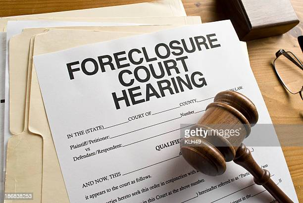 A sheet of paper that is a foreclosure court hearing