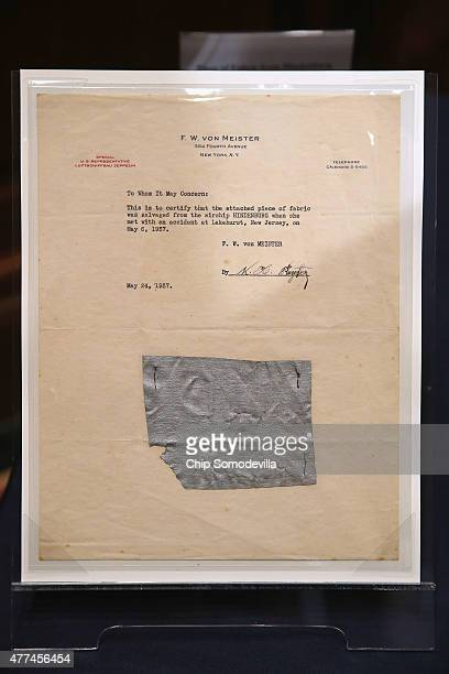 A sheet of stationary with letterhead of FW von Meister with a piece of a salvaged portion of the Hindenburg stapled to it is displayed before a...