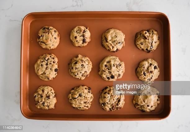 sheet pan of freshly baked chocolate chip cookies shot from above - dozen stock pictures, royalty-free photos & images