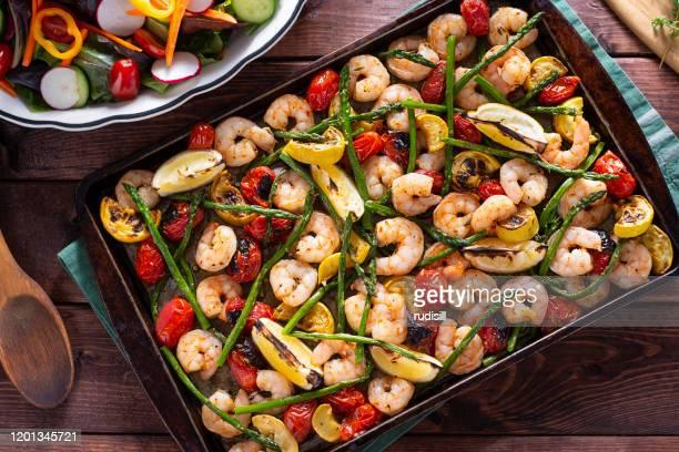 sheet pan shrimp - baking sheet stock pictures, royalty-free photos & images