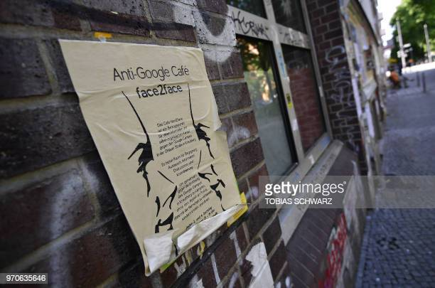 A sheet promoting an antiGoogle cafe is pictured in Berlin's Kreuzberg district on May 22 2018 Global cities from Seoul to Tel Aviv have welcomed...
