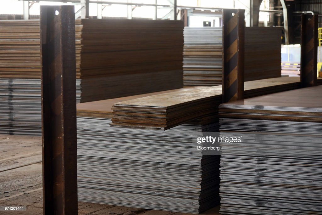 Sheet steel sits stacked in the store room at the SAW Pipe Mills, operated by Liberty Commodities Ltd., in Hartlepool, U.K., on Thursday, June 14, 2018. Steel and aluminumtariffsimposed by the U.S. in March may already be filtering through to prices charged by American producers of the metals. Photographer: Chris Ratcliffe/Bloomberg via Getty Images