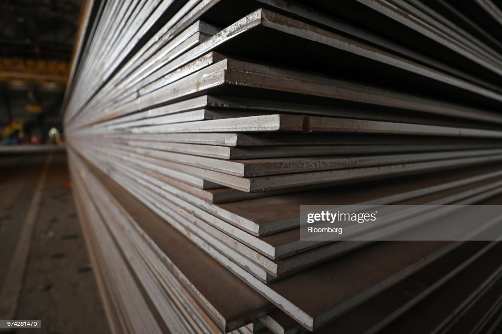 Sheet steel sits stacked in the store room at the SAW Pipe Mills, operated by Liberty Commodities Ltd., in Hartlepool, U.K., on Thursday, June 14, 2018. Steel and aluminum tariffs imposed by the U.S. in March may already be filtering through to prices charged by American producers of the metals. Photographer: Chris Ratcliffe/Bloomberg via Getty Images