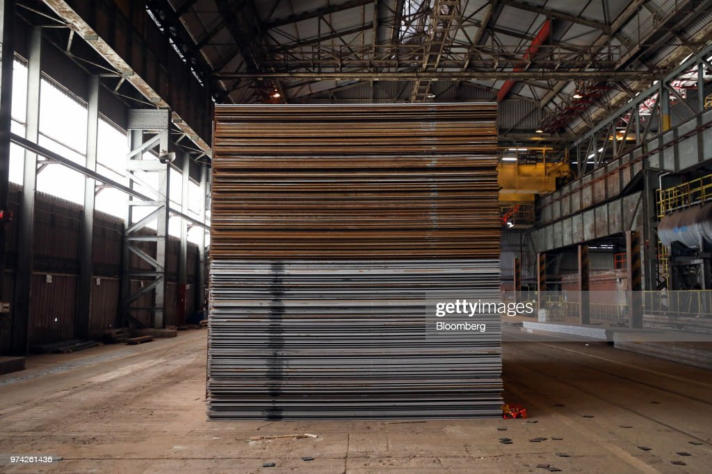 Sheet steel stands in the store room at the SAW Pipe Mills, operated by Liberty Commodities Ltd., in Hartlepool, U.K., on Thursday, June 14, 2018. Steel and aluminum tariffs imposed by the U.S. in March may already be filtering through to prices charged by American producers of the metals. Photographer: Chris Ratcliffe/Bloomberg via Getty Images