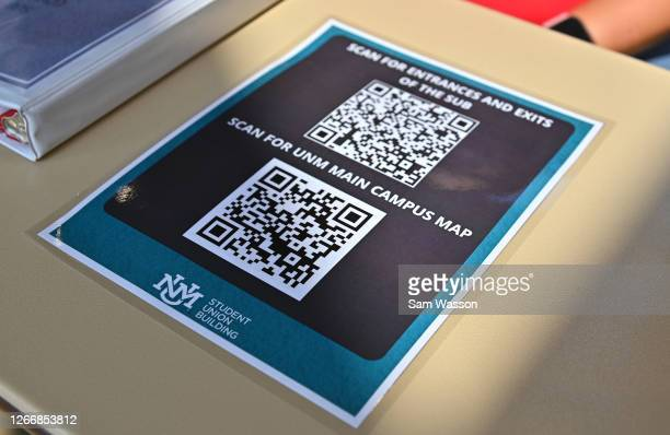 Sheet with QR codes is displayed on an information table as students begin classes amid the coronavirus pandemic on the first day of the fall 2020...
