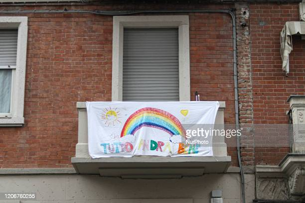 A sheet with the words Andr Tutto bene exports outside a balcony on the outskirts of Turin Italy on March 12 2020 after the Italian prime minister...