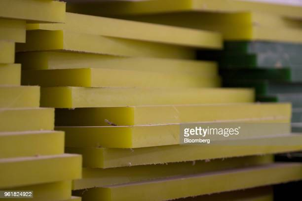 Sheets of acrylic imported from Europe are stacked on a factory floor in New York US Photographer Scott Eells/Bloomberg via Getty Images