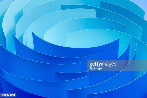 sheets of blue paper in a circle, close up - concentric stock pictures, royalty-free photos & images