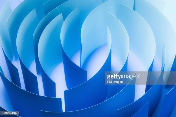Sheets of blue paper in a circle, close up