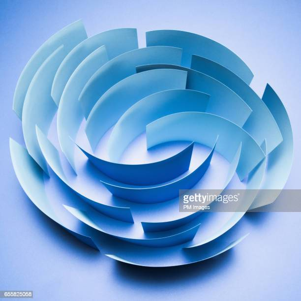 Sheets of blue paper in a circle