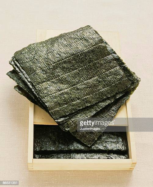 sheets of nori in box - nori stock pictures, royalty-free photos & images