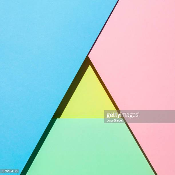 Sheets of paper in pastel colors forming a triangle