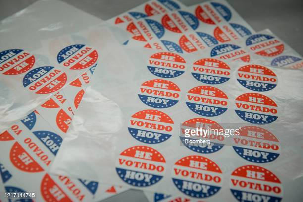 """Sheets of stickers reading in Spanish """"I Voted Today"""" are displayed on a table at a polling station inside a Baptist Church in Philadelphia,..."""