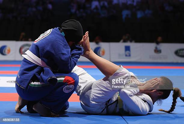 Shefaa Moosa Hassan of United Arab Emirates reacts after losing to Amelia Lui of Great Britain in the Women's white belt open weight finals during...