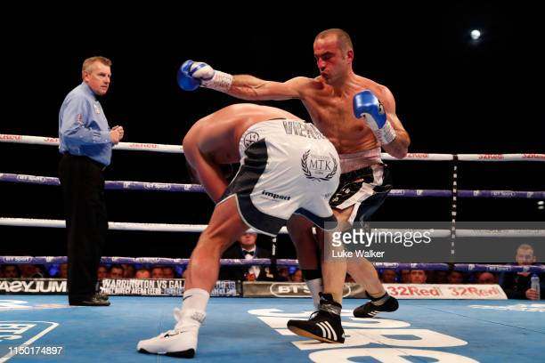 Shefat Isufi punches Billy Joe Saunders during the WBO WORLD SUPERMIDDLEWEIGHT CHAMPIONSHIP at The Lamex Stadium on May 18 2019 in Stevenage England