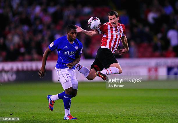 Sheffield United captain Michael Doyle is challenged by Chesterfield player Franck Moussa during the npower League One game between Sheffield United...