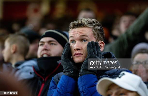 Sheffield United fans await the VAR decision for their third goal during the Premier League match between Sheffield United and Manchester United at...