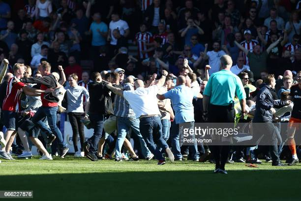 Sheffield United fans invade the pitch after Leon Clarke had scored his sides first goal during the Sky Bet League One match between Northampton Town...