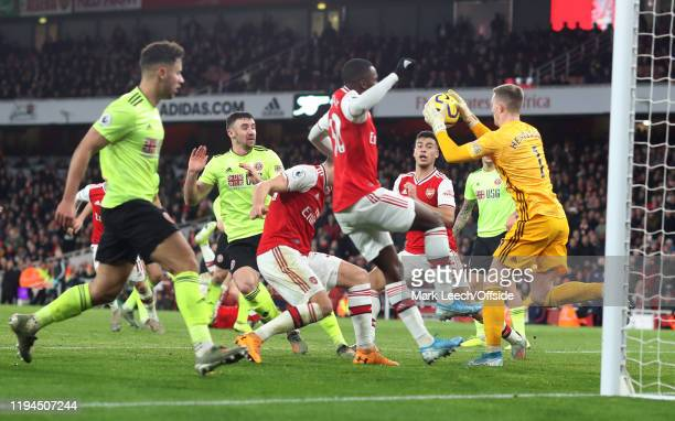 Sheffield United goalkeeper Dean Henderson gathers the ball as Arsenal attack during the Premier League match between Arsenal FC and Sheffield United...