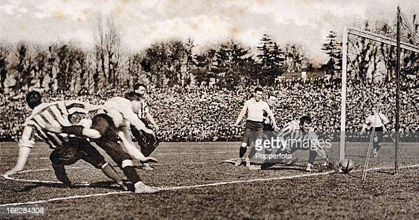 Sheffield United goalkeeper William 'Fatty' Foulke is relieved to see the ball go narrowly wide of his goal during the English FA Cup Final between...