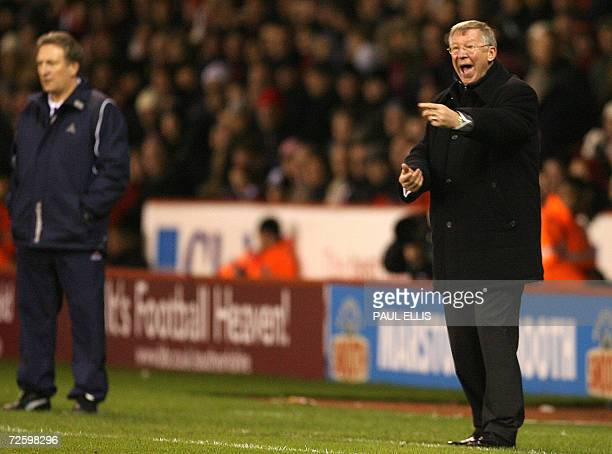 Manchester United manager Sir Alex Ferguson shouts at his team as Sheffield United manager Neil Warnock looks on during their English Premiership...
