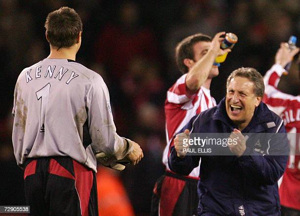 Sheffield, UNITED KINGDOM: Sheffield United manager Neil Warnock congratulates stand in goalkeeper Paul Jagielke after they beat Arsenal 1-0 during...