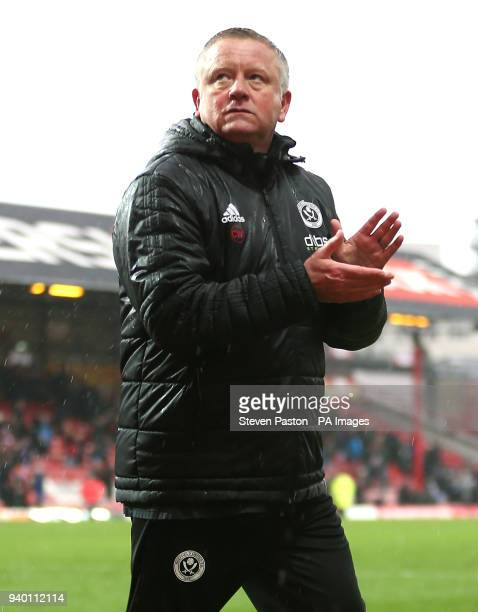 Sheffield United manager Chris Wilder applauds the fans after the final whistle during the Sky Bet Championship match at Griffin Park London