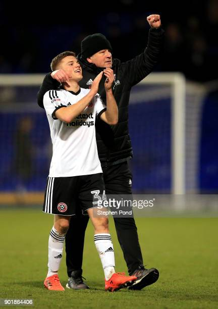 Sheffield United Manager Chris Wilder celebrates victory with Regan Slater after the Emirates FA Cup third round match between Ipswich Town and...