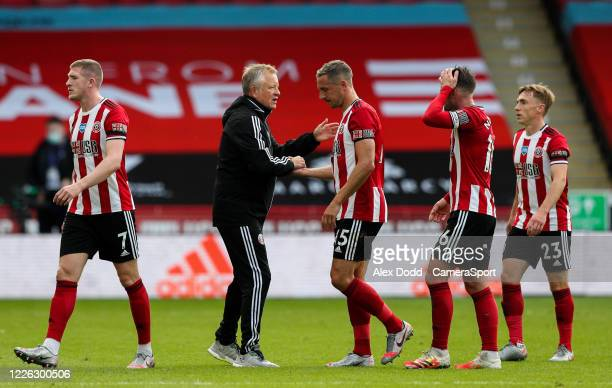 Sheffield United manager Chris Wilder congratulates his players after the Premier League match between Sheffield United and Chelsea FC at Bramall...
