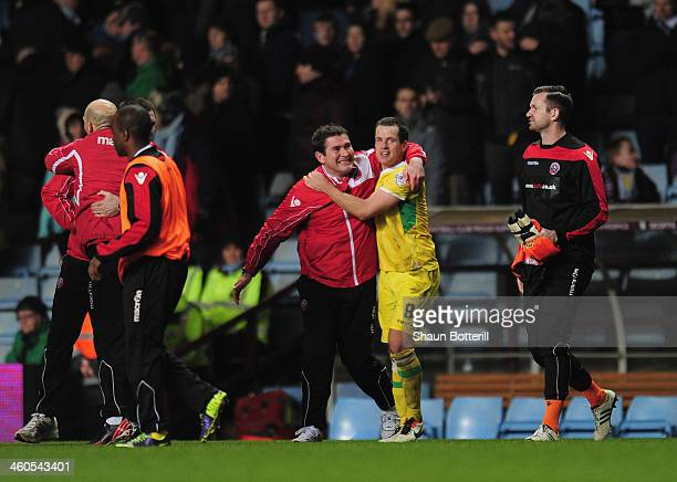 Sheffield United manager Nigel Clough celebrates with captain Michael Doyle after winning the Budweiser FA Cup third round match between Aston Villa...