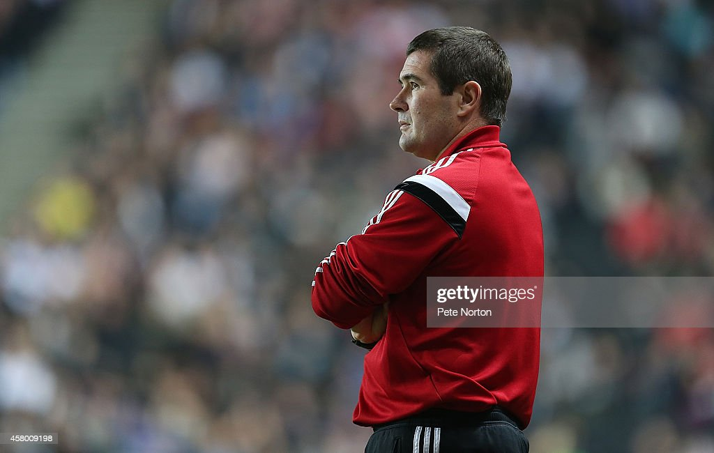 Sheffield United manager Nigel Clough looks on during the Capital One Cup Fourth Round match between MK Dons and Sheffield United at Stadium mk on October 28, 2014 in Milton Keynes, England.