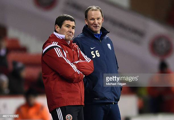 Sheffield United manager Nigel Clough looks on with Preston manager Simon Grayson during the FA Cup Fourth Round match between Sheffield United and...