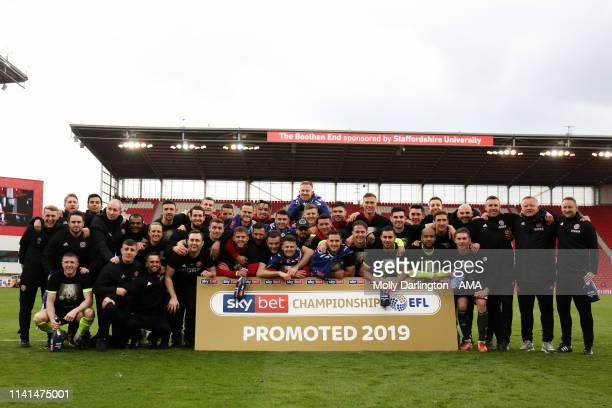 Sheffield United players and staff after promotion to the Premier League during the Sky Bet Championship match between Stoke City and Sheffield...
