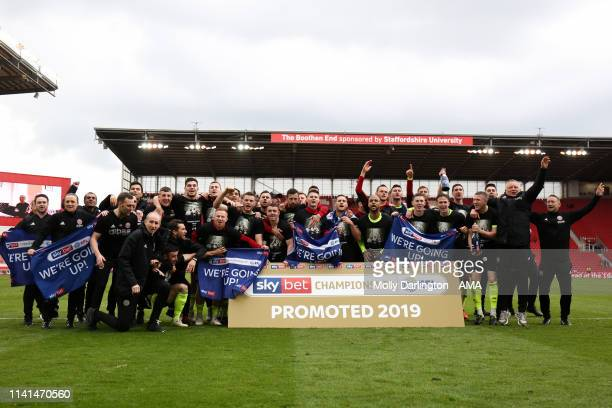Sheffield United players and staff celebrate promotion to the Premier League during the Sky Bet Championship match between Stoke City and Sheffield...