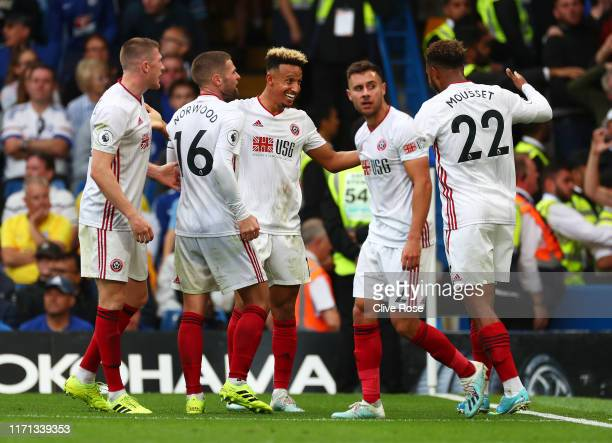 Sheffield United players celebrate after their team's second goal, an own goal from Kurt Zouma of Chelsea during the Premier League match between...