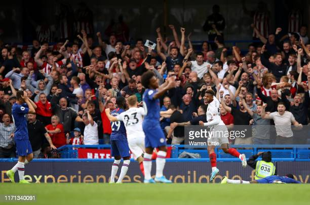Sheffield United players celebrate after their team's second goal during the Premier League match between Chelsea FC and Sheffield United at Stamford...