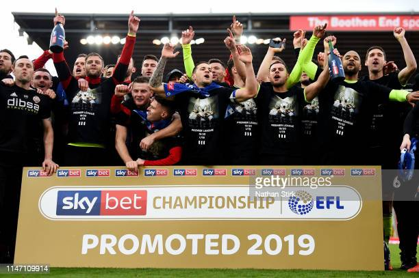 Sheffield United players celebrate their promotion after the Sky Bet Championship match between Stoke City and Sheffield United at Bet365 Stadium on...