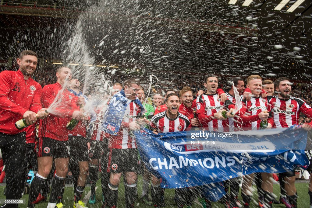 Sheffield United players celebrate winning promotion to the Sky Bet Championship after the Sky Bet League One match between Sheffield United and Bradford City at Bramall Lane on April 17, 2017 in Sheffield, England.
